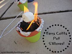 My World - Made By Hand: Terra Cotta Pot S'Mores! {tutorial} - We *have* to do this! I love campfire foods like this, but I have no idea how to safely (and aesthetically) build a fire pit in the backyard. This is the perfect solution.