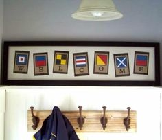 Say it with signal flag art. Framed art & banner. Or make your own: http://www.completely-coastal.com/2014/08/nautical-signal-flag-decor-word-art.html