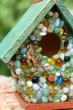 Miniature Green Stone  Mixed Media Birdhouse by TheVelvetRobyn, $18.00....I would LOVE to do something like this with some of the small bits and pieces of shells and sea glass I've found.  Would be SO cute...kind of obssessed with bird houses lately...LOL