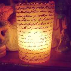 Mod podge + Old glass candle holder + scrapbook paper= romantic candle