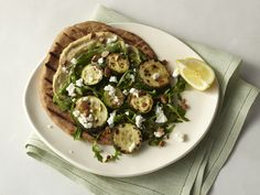 Roasted Zucchini Flatbread with Hummus, Arugula, Goat Cheese, and Almonds.