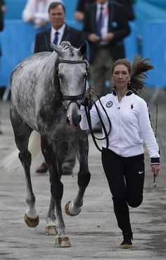 USA's Tiana Coudray runs with her horse Ringwood Magister during horse inspection for the equestrian eventing competition at Greenwich Park July 27.