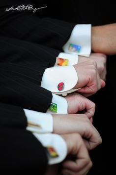 Custom superhero cufflinks for the groomsmen! -- Not exactly a favor, but too cool!