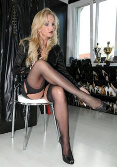 Very sexy lady in black stockings on great legs!!