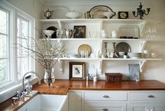 butcher block countertops and open shelving can keep costs down whilst still allowing for storage