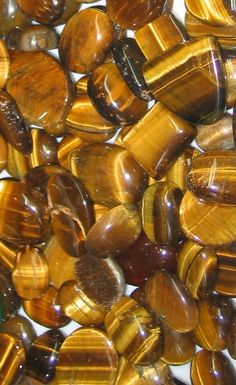Tiger Eye: brings in the energy from the sun to combine it with the earth's to enhance psychic abilities; this grounding stone aids in organizing otherwise spacey thought patterns.