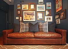 Sports-themed #gallerywall - love those burl wood #customframes & how the dark walls make them POP!
