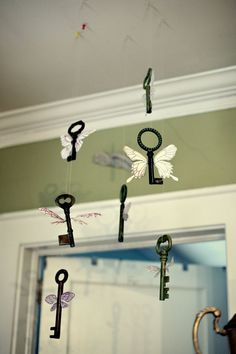 Winged keys mobile...for the HP kid's room that I've been planning in my head for years.