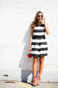 Blogger Chic Flavours accessorizes her Gap striped fit & flare dress with red accents.