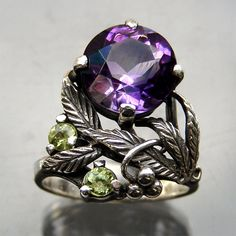Bernard Instone. Arts and Crafts ring. Silver, amethyst and peridot. Sold by Tadema Gallery.