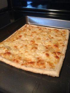 White pizza with honey, garlic, rosemary olive oil, mozzarella, provolone, and truffle salt.