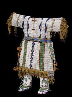 Sicangu Lakota (Sioux) girl's dress, ca. 1890, moccasins, ca. 1900, and leggings, ca. 1895. Hide, seedbeads, tin cones, sinew.