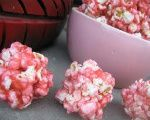 "Maybe add some crasins or something else red to the pink popcorn balls just to ""spice"" them up, snack for Isabelle's class."