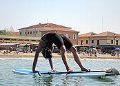 Sup-Yoga   Yoga on Water in Castiglione della Pescaia