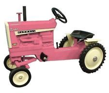 Not clothes but she NEEDS this!!      Farmall 1206 Pink Pedal Tractor NIB! Made In USA! 2013 PA Show!
