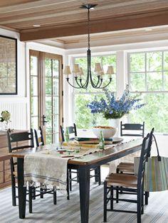 barnwood table...natural light...white walls...wood tones...timber wood ceiling beams...grainsack runner