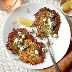 Zucchini Fritters with Herb-and-Mozzerella Salad | Squeezing the zucchini in paper towels helps remove excess water for a crisp, latke-like crust.