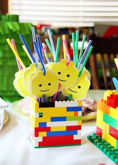 Lego Birthday Party.  Make one of these lego head straw toppers and put into the gift bag for straws or pencils.