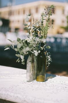 bottle centerpieces, photo by Sarah Beth Photography http://ruffledblog.com/intimate-louisiana-wedding #reception #wedding