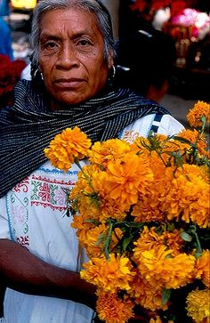 This Purepecha woman was carrying home the cempasuchiles (marigold flowers) that she had bought at the flower market in Parzcuaro,Michoacan when she kindly allowed me to take her portrait.