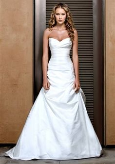 Jenny Lee wedding dress with ruching and a fit-n-flare silhouette.  Sweetheart neckline in white or ivory