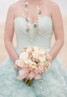 baby blue wedding dress and a pale pink bridal bouquet