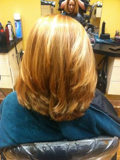 Strawberry blonde all over color with blond and burgundy highlights