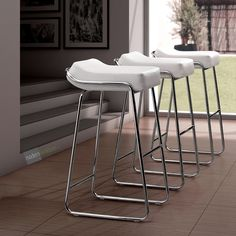 With its thick, comfy cushion and elegant yet modern frame, the Wedge Barstool will add the finishing touch to any setting. #barstool #bar #homedesign #interiordesign