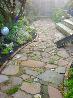 Bellingham Garden - I love this idea for a garden path - flat stone, moss, other keepsakes