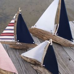 handmade driftwood sailboats...could be cute place cards on a nautical themed table - print name on sail!