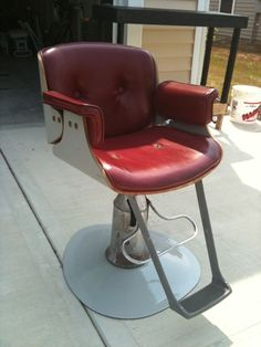 I'm in love with vintage barber chairs...this one reminds me of an old restaurant booth.