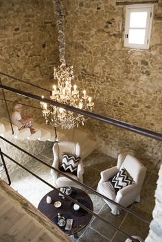 love stone walls with crystal chandeliers!