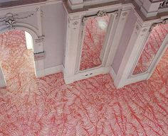Germany-based artist Heike Weber uses permanent markers to fill empty white spaces of walls, floors and ceilings of rooms.   In her massive installations that are bound to make you feel dizzy, she draws curves in various widths in one color to make it seem as if the room is moving.