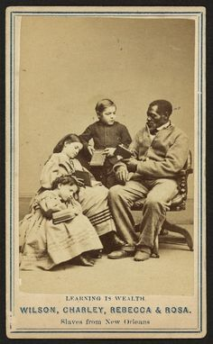 """Learning Is Wealth."" Wilson, Charley, Rebecca & Rosa 1863.  (The 3 children are of mixed race ancestry.) Enslaved man & children in New Orleans, reading"