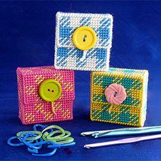 Make a handy holder for your knitting and crochet stitch markers, using plastic canvas and needlepoint.