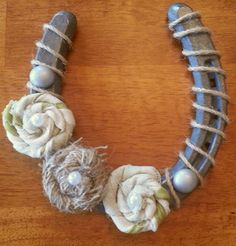 Decorate an old horseshoe with scrap materials and then hang above a door in your home to symbolize good luck. :) I love this blog!