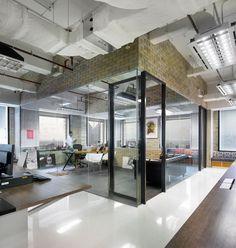 Gorgeous office space    Bates 141, M Moser Associates. Reclaimed warehouse space. Concrete glass brick