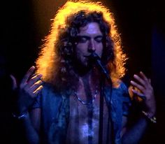 Robert working his magic The Song Remains the Same @ Robert Plant | Flickr - Photo Sharing!