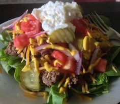 Cheeseburger Salad: Ground beef cooked with onion soup mix (or omit, if you prefer) with tomato, mild cheddar, dill pickles, onion, a drizzle of mustard and a blob of mayo atop a bed of fresh spinach.
