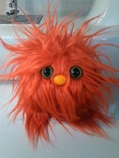 Furry Monster Plush - 4 Orange Coodle. $10.00, via Etsy.