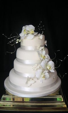 white orchids wedding cake: looking at ORCHIDS to get ideas on how to do them on our wedding cake.