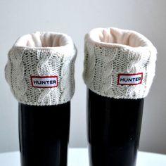 Hunter rain boots w/ sweater cuffs.