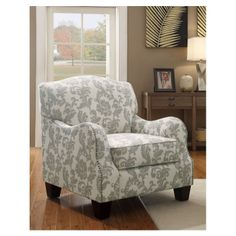 I really like this comfy and lovely arm chair, with beige and gray damask-print linen upholstery and nailhead trim.