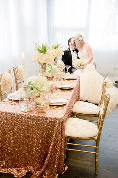 Ultra glamorous gold reception decor with sparkly table linen and soft pink flowers