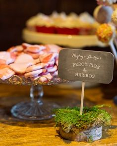 This couple chose gummy candies as their favorite treat on the dessert table. See more of this rustic wedding in the English countryside!