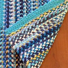 Handmade Rag Rug -  this would be so easy to do with a home made knitting loom! so clever!