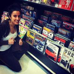 Miss Mopar (Michaela Brass) finds the issue of Chrysler Power featuring her story on the newsstands at Giant Grocery