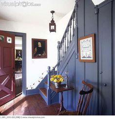 Gorgeous colonial style home! Love the painted woodwork and stenciling!