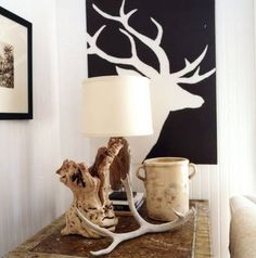 decorating with antlers - man cave, easy to recreate with large canvas and traced deer/buck. Like the black & white