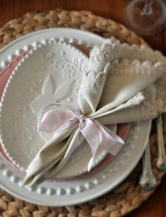 Love the white on white dishes and exquisite linen napkin w/bow - so elegant